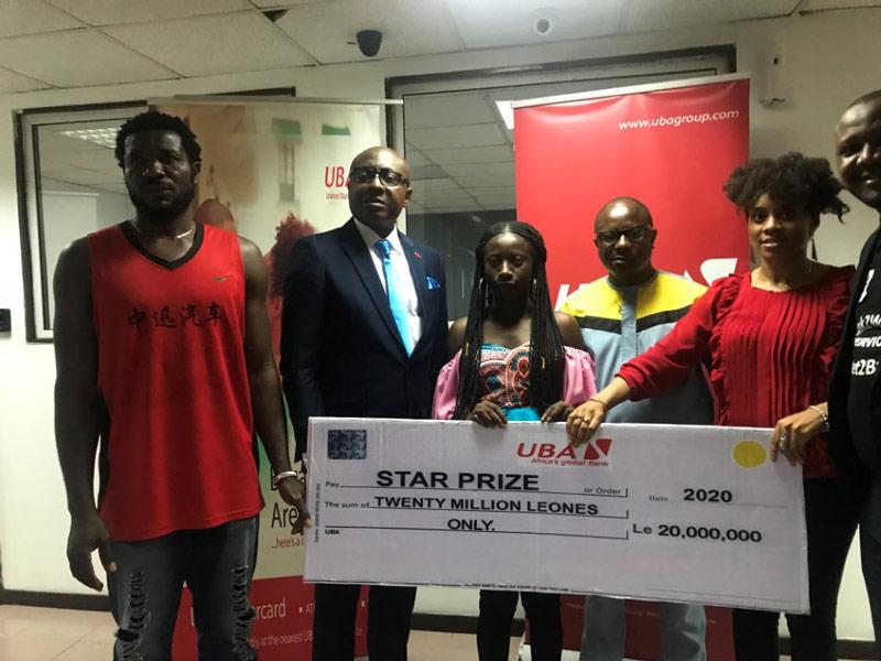 UBA sierra leone presents two thousand dollars to winner of savings promo