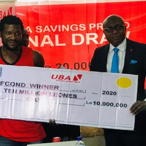 UBA sierra leone presents two thousand dollars to winner of savings promo